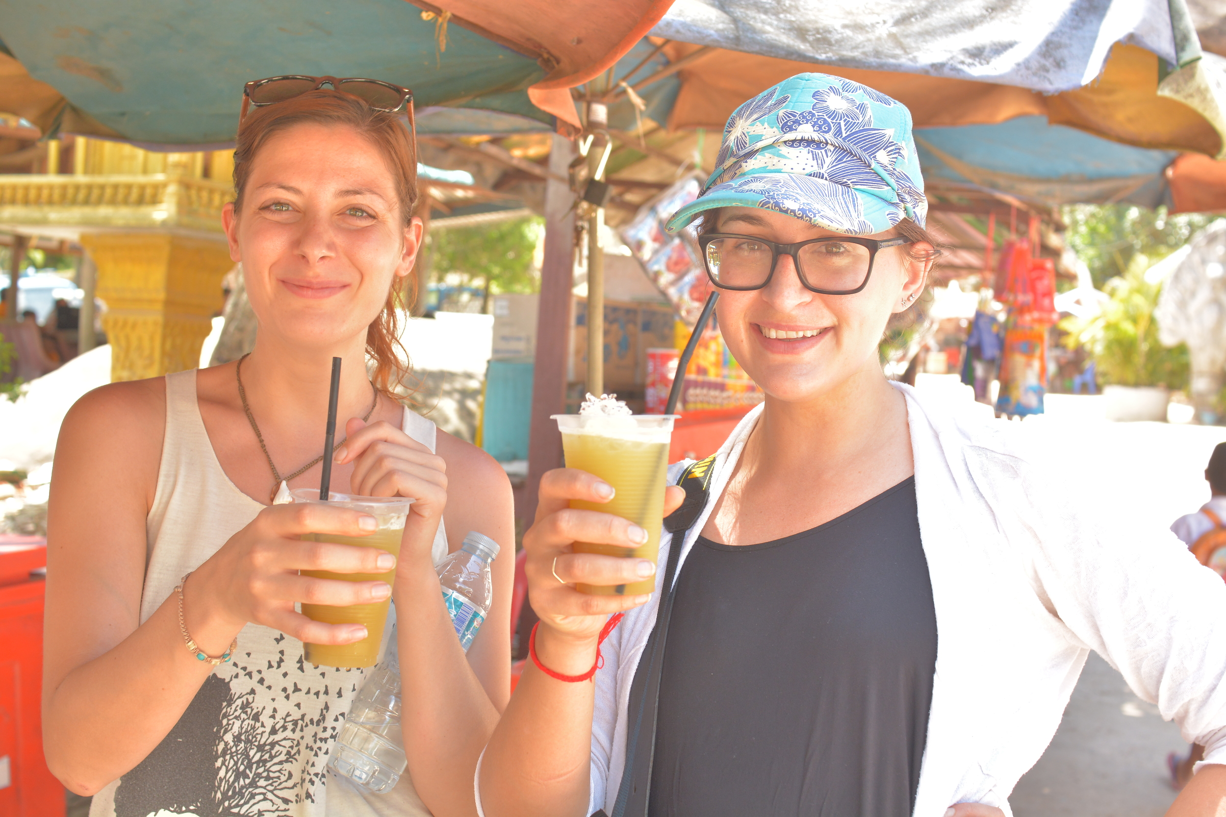 Robbie (Roberta) and Sophi enjoy freshly squashed and drained Sugar Cane juice, Kbal Spean