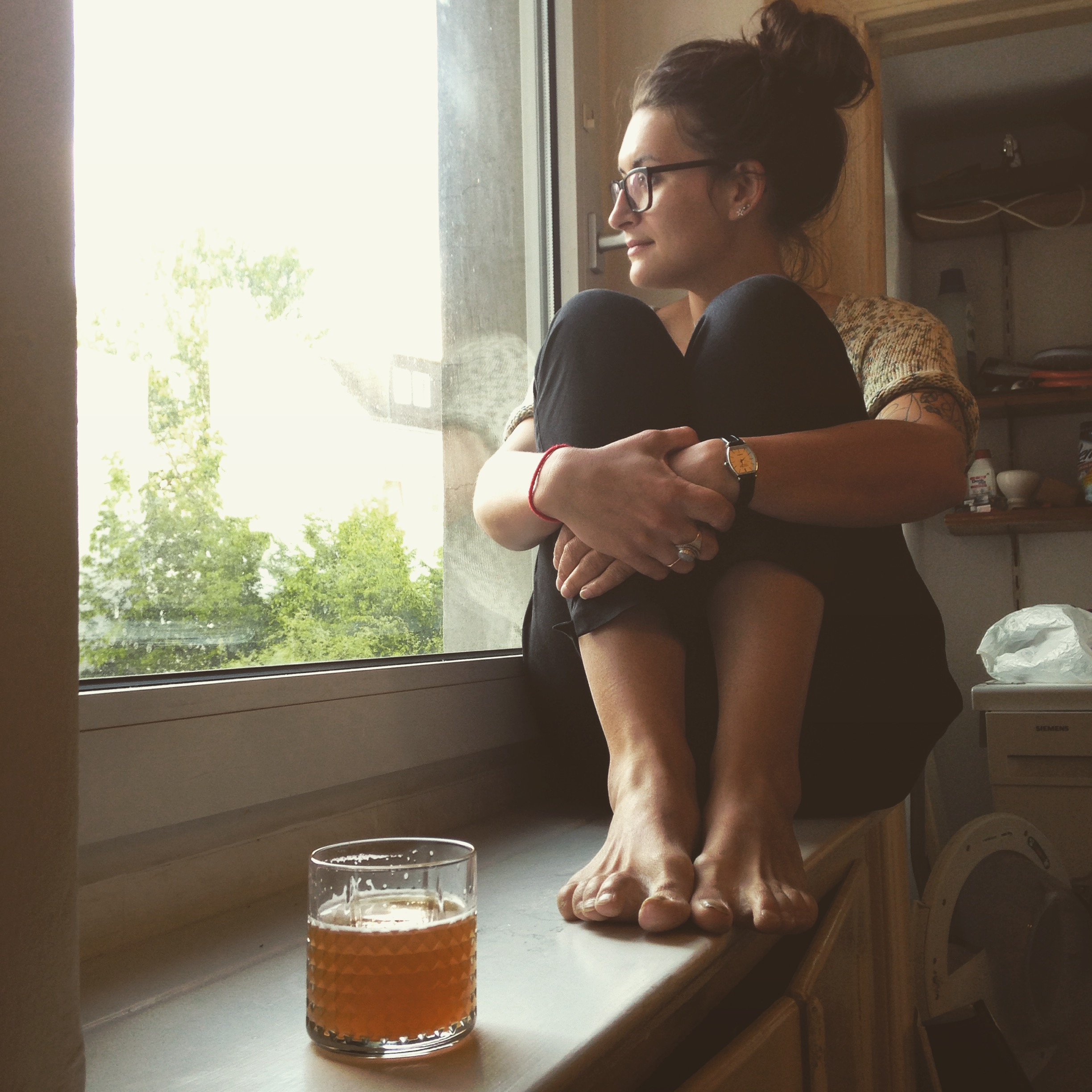 Sophi enjoying a beer at Ant and Laura's beautiful flat