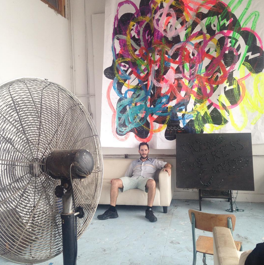 Mark chilling beneath a Mike Roth artwork, Sky Fortress resident