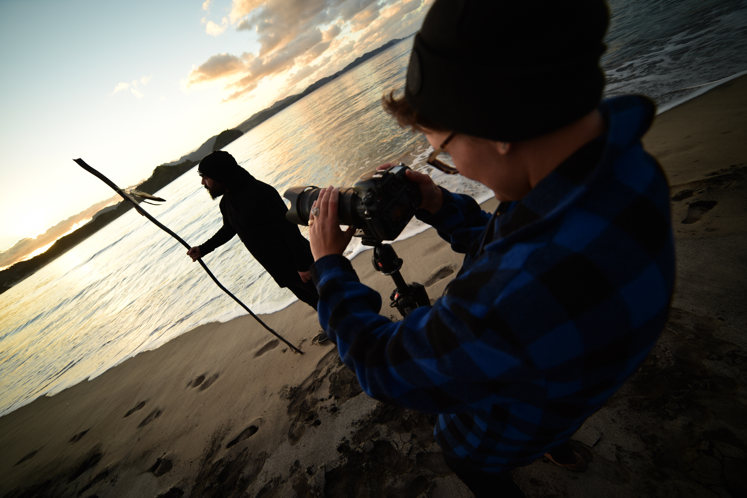 Sophi lining up a shot of James on Medlands Beach, Great Barrier Island.