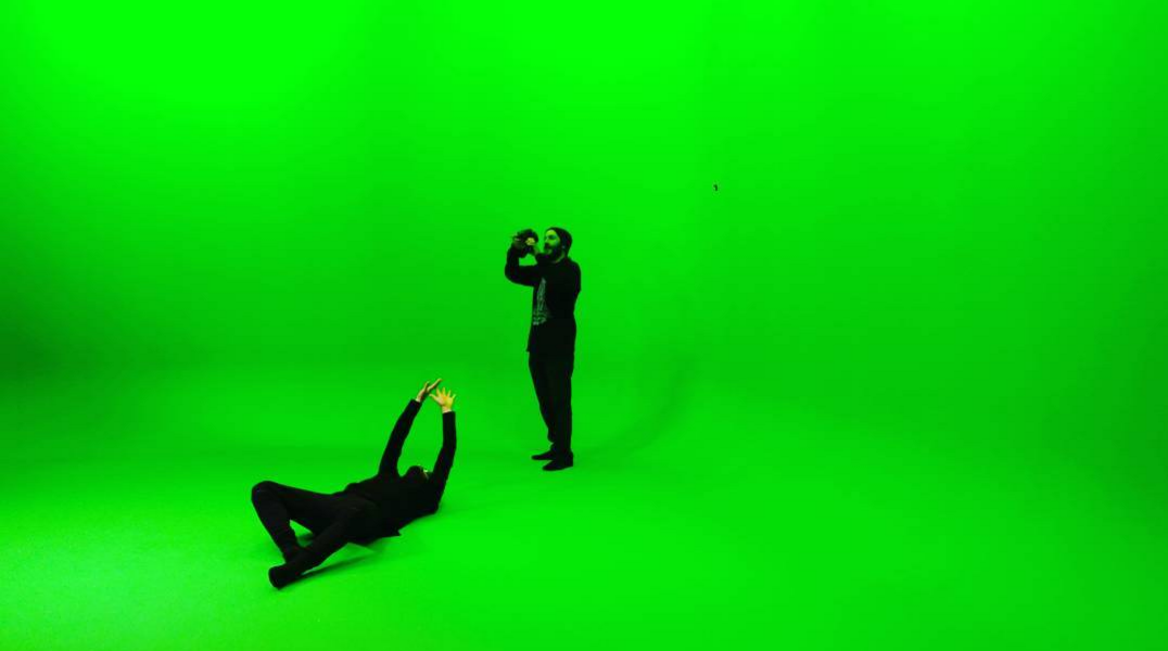 Mark and Ryan getting some Dark Arts on. Note: the black dot is a dead pixel on Mark's phone's camera not a mark on the green screen!