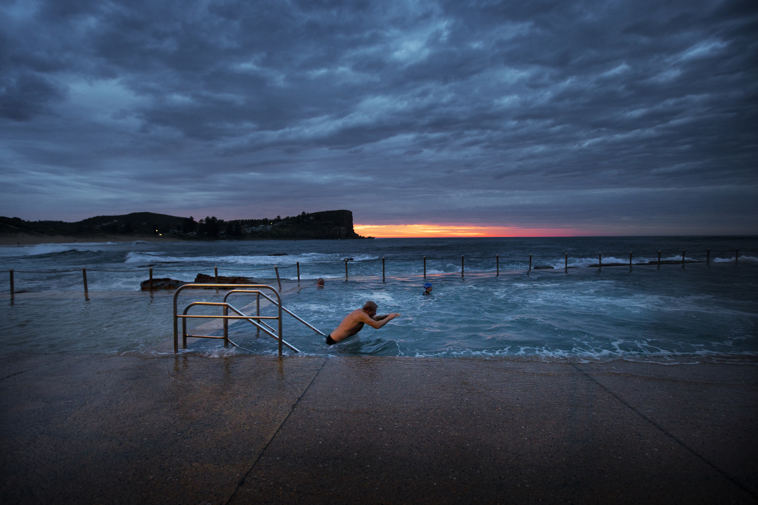 October brought the clocks forward and meant the early morning crew had to get started under the incandescent glow of street lamps rather than the solar version they had been used to. Early morning swimmers at Avalon Beach ocean pool test their perseverance against the cold, dark and sometimes wet conditions.