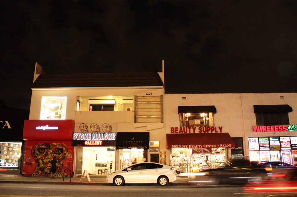 THE BLACK ONNING IN THE CENTER OF THE SHOT IS LENCERIA, NESTLED BETWEEN A GALLERY AND BEAUTY SUPPLY ON MELROSE.