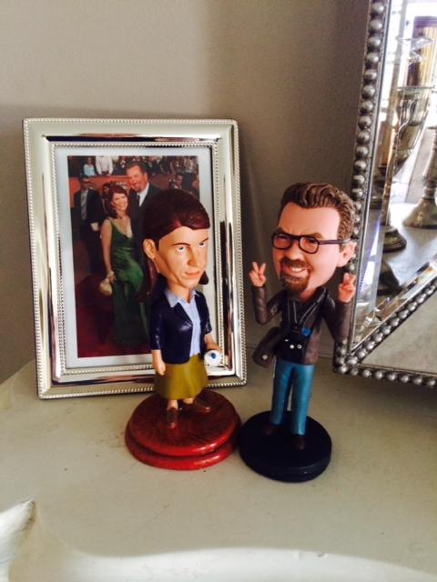 """Kate's """"Office"""" bobble head her boyfriend's matching one."""