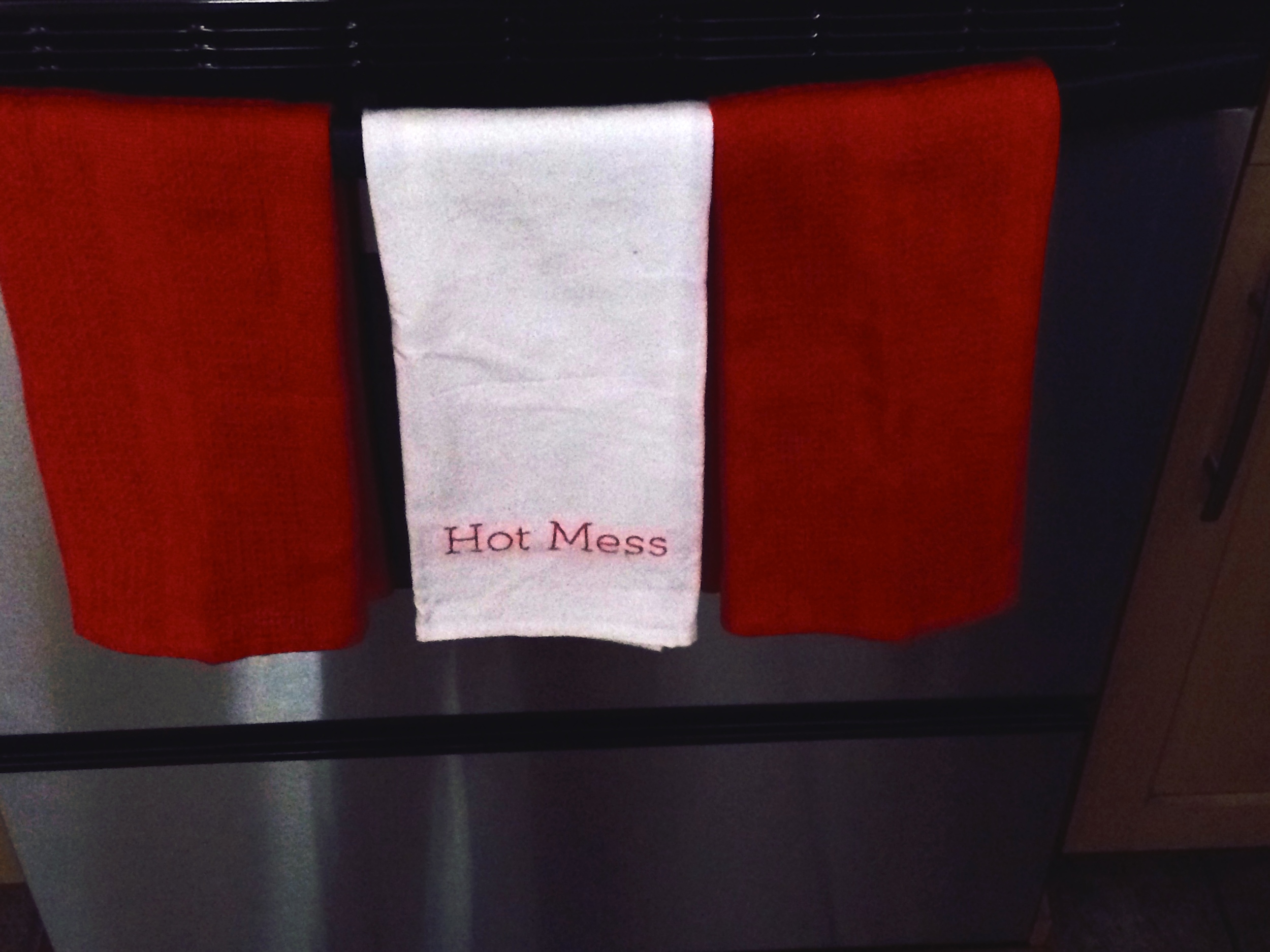 The Hot Mess kitchen towel that was inspired by Coco's Whore plate.