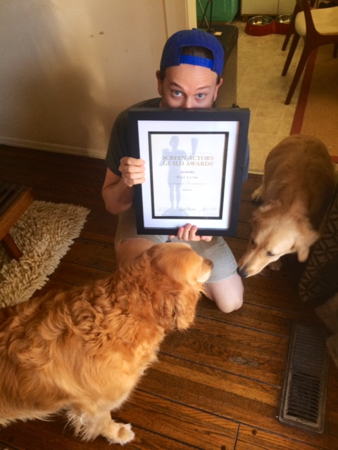 "Tom, at home, with his dogs and his SAG Award certificate for ""Argo."""