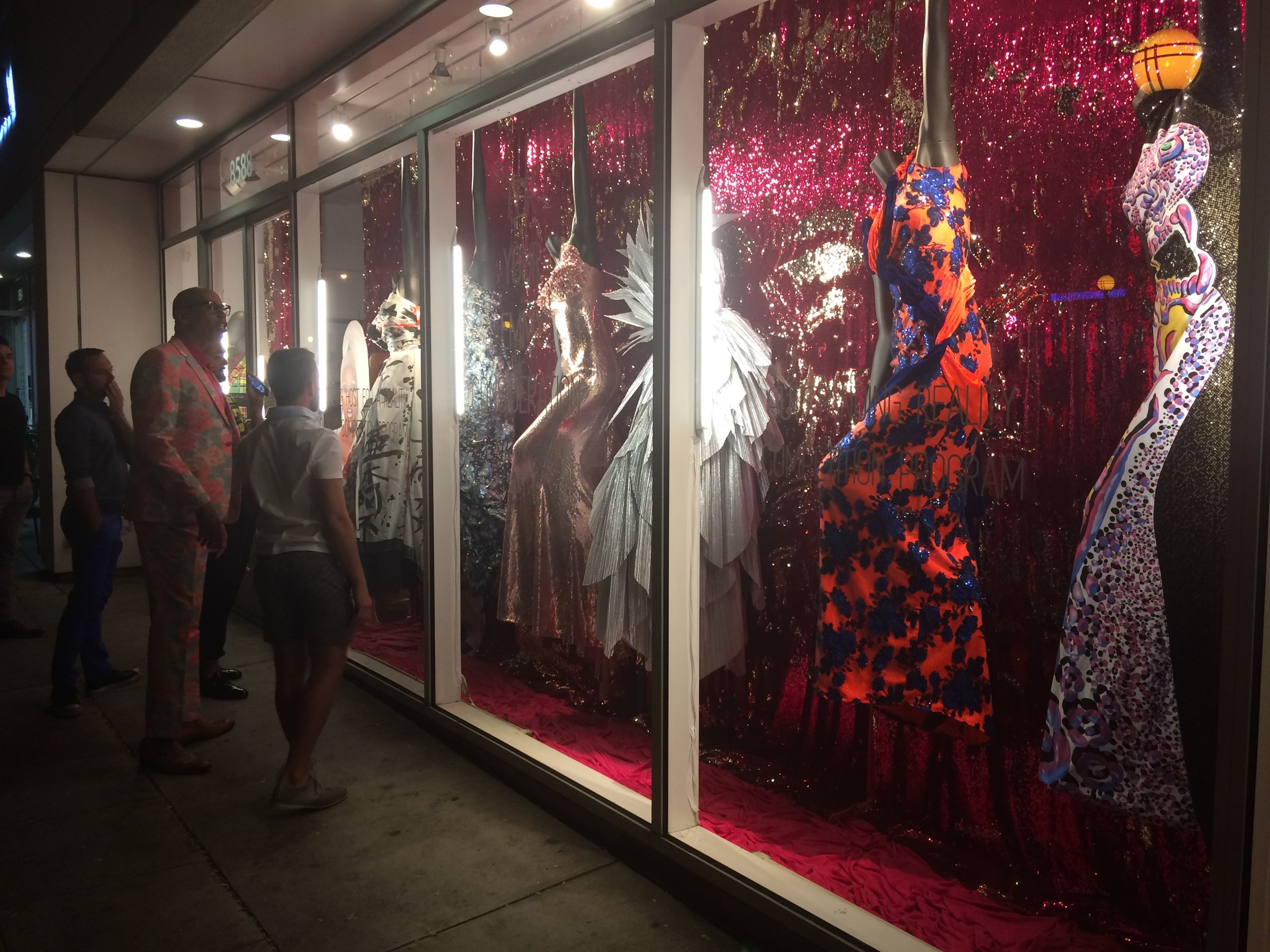 RuPaul checks out the window display of his Drag Race dresses