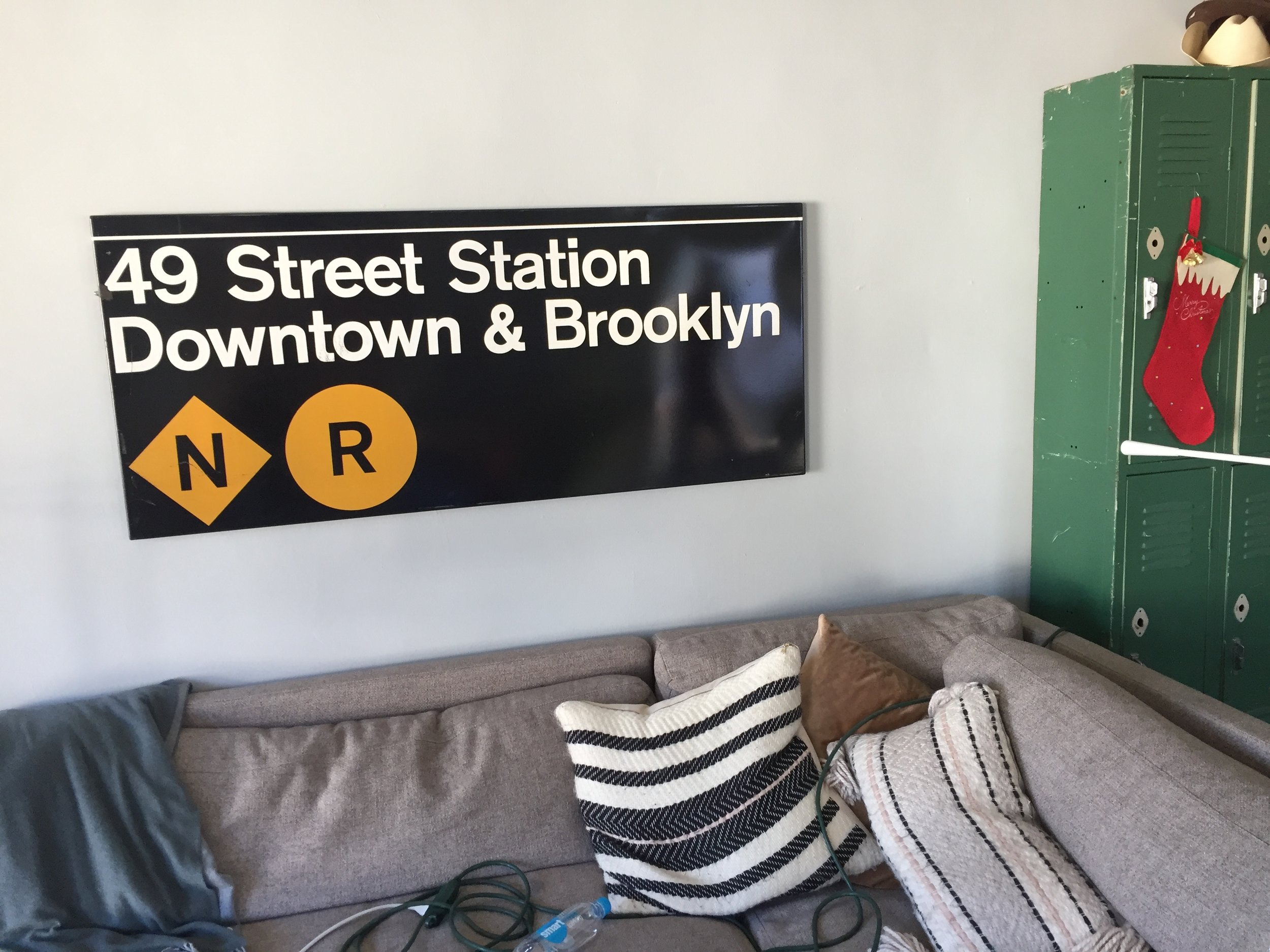 The subway sign from where they had their first kiss.