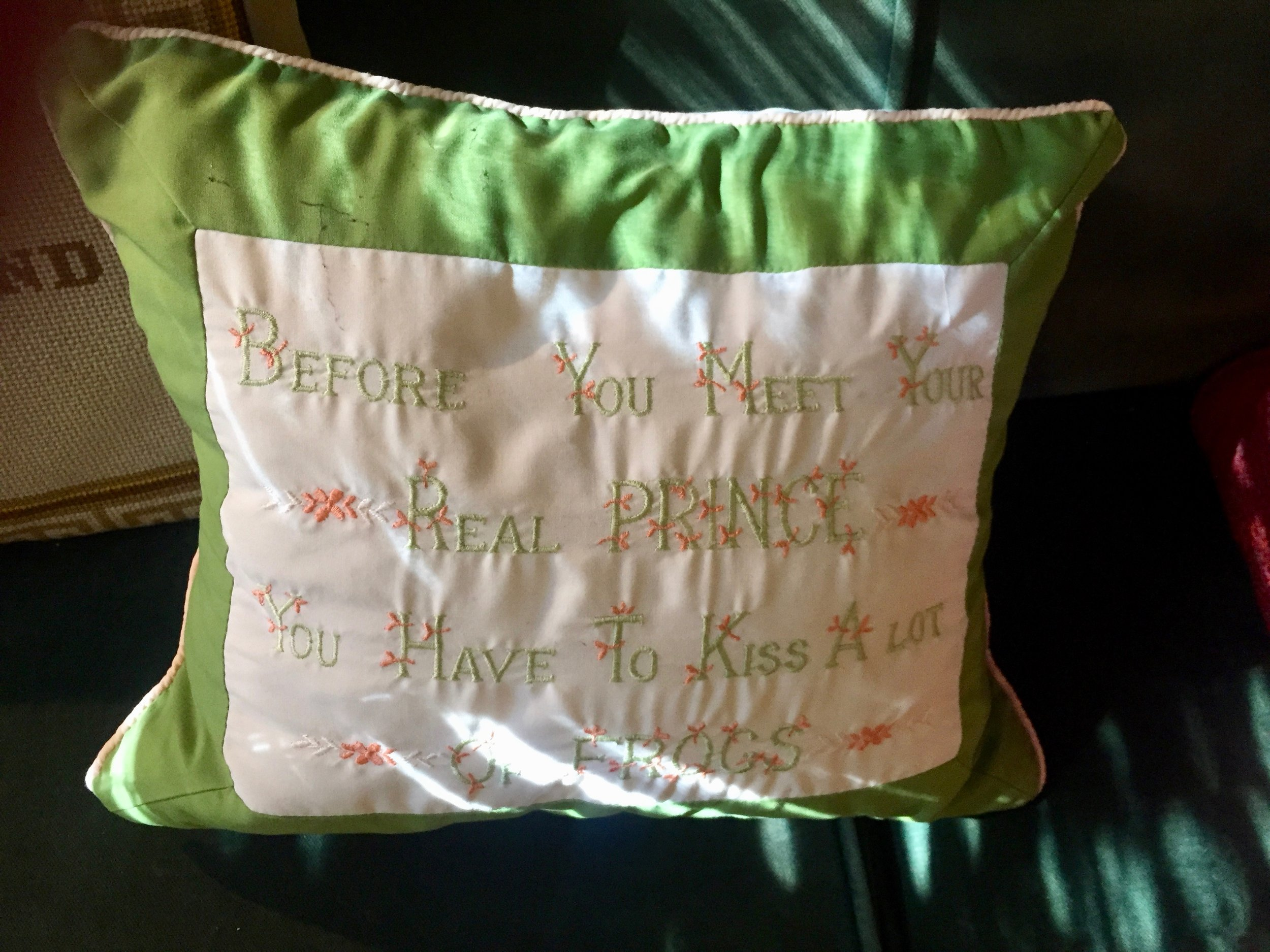 The embroidered pillow Phillip bought at Zsa Zsa Gabor's yard sale.