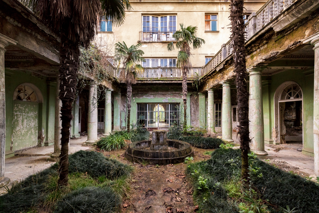 Vegetation takes over a garden inside a former Sanatorium in Georgia. Image - March 2018.