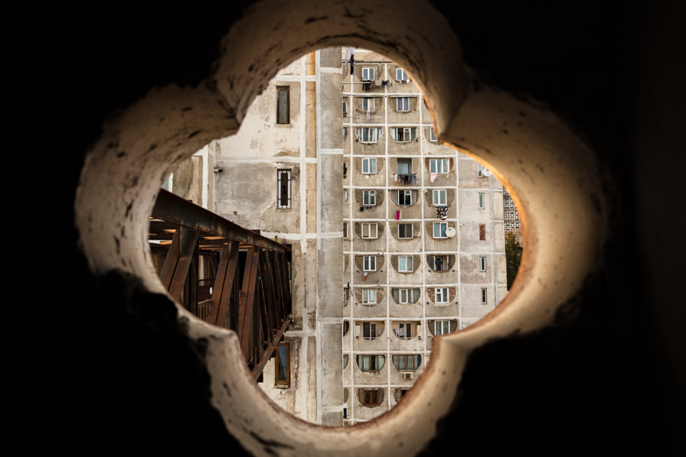 Brutal Architecture / Through the small window looking at a sky bridge.