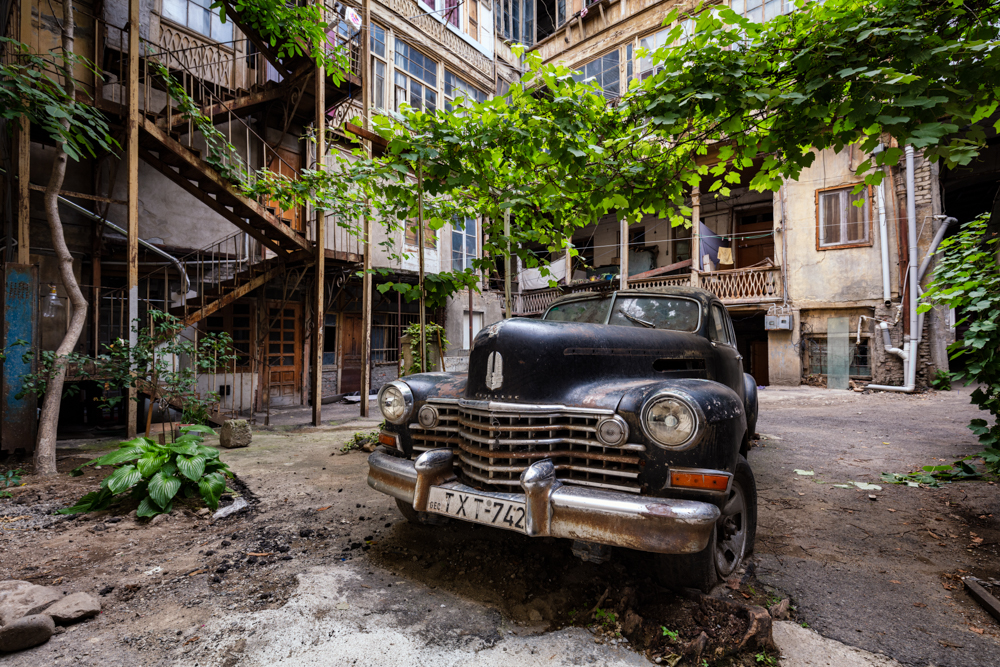 Cadillac / A disused car resides in a courtyard in Tbilisi.