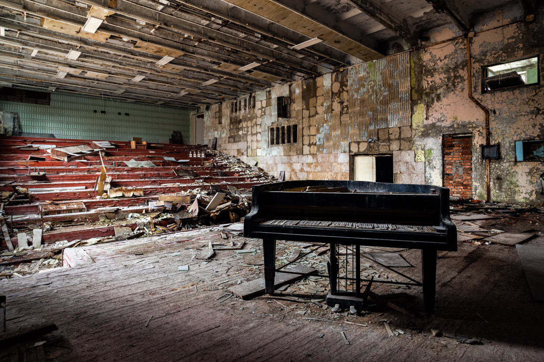 IMAGE 1 - A piano sits on the now defunct stage in the music school - image 2015. An angled composition.
