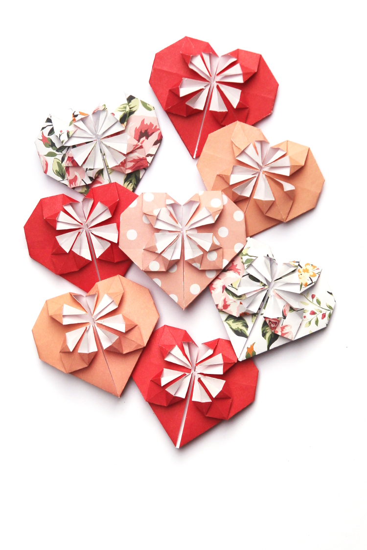 Learn how to make a sweet origami blossom heart. This simple tutorial shows you how to make a pretty paper heart that's a lot easier than it looks #origami #heart #origamiheart #valentinescrafts #valentinesday #papercrafts #gatheringbeauty
