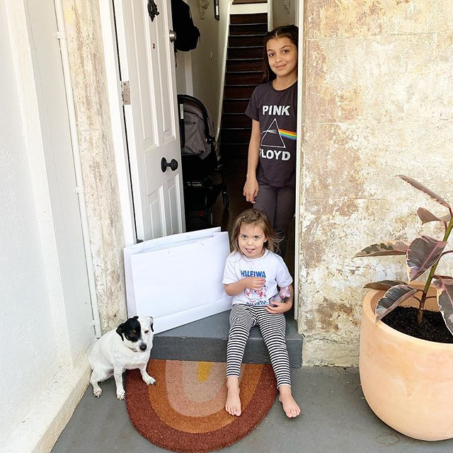 We've been loving our little front door stoop lately. We've already decorated for Halloween and the girls like to go visit the fake spider webs and check-in on the skeleton bones hiding in our garden bed! #frontdoorlove