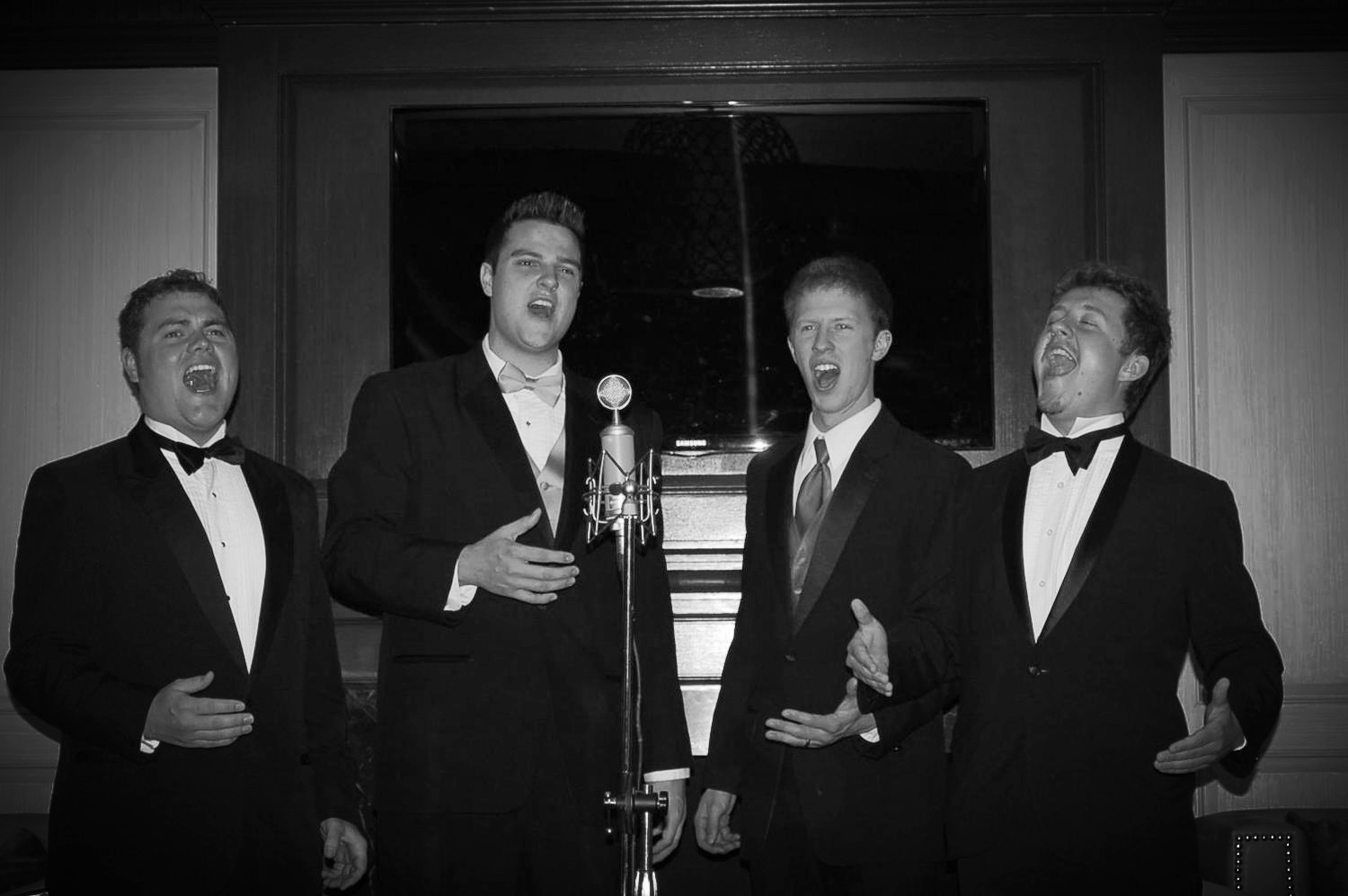 Derrek Wayne (far right) holds a high note with his a cappella quartet on Celebrity Cruises in 2012.