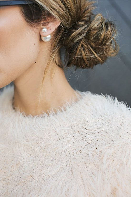 Hair worn pulled back will never fade from style and perfectly complements a classic wardrobe - Plus it shows off those fabulous pearl earrings!