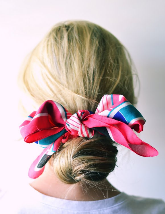 A scarf worn in the hair is always classic