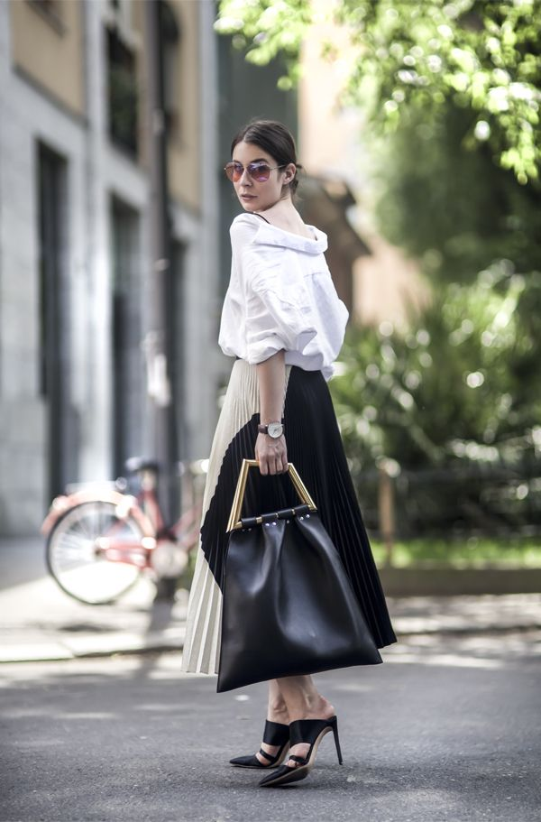 The Mule makes a grand re-entry and is a must have shoe for every wardrobe. Image via  All For Fashion Design.