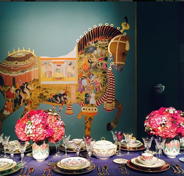 Always sublime, always elegant, the Hermès's table, under an ornate equine decoration, featured the brand's new tableware line, Voyage en Ikat. Image via Jessica Gordon Ryan.