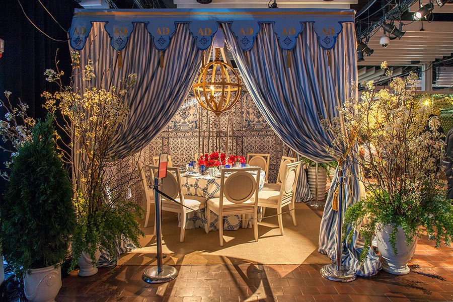This spectacular table created by the folks at Architectural Digest takes homage to the  Château de Groussay which was built in 1815 but underwent an expansion in 1952 that included the addition of several follies on the grounds. The Tartar Tent, constructed in 1960 resembles a 1781 structure at Drottningholm Palace in Sweden. Image via Architectural Digest.