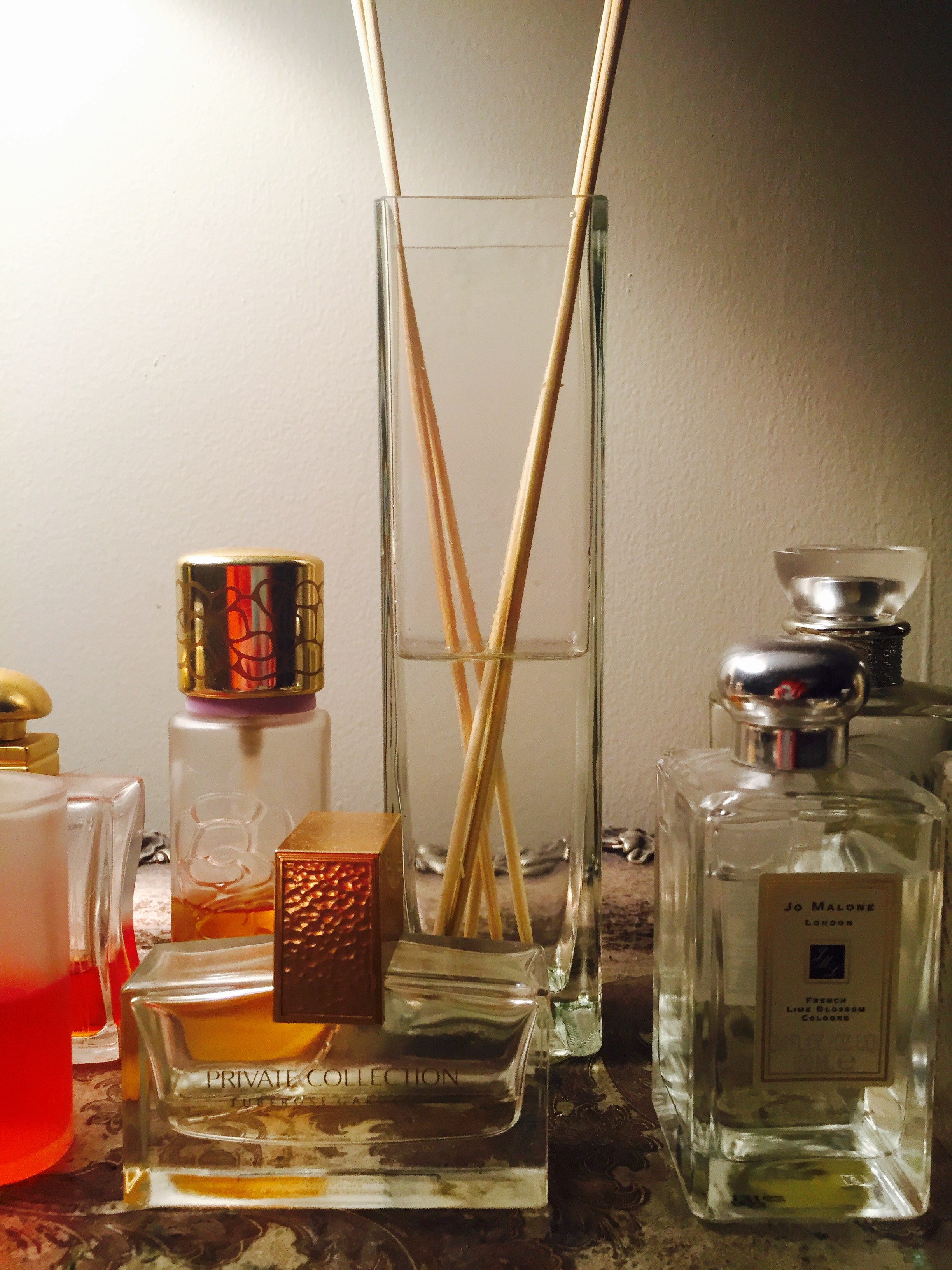 How to make your own reed diffusers. An old bud vase acts as a perfect vehicle for a diffuser - blending perfectly among my perfume on my vintage silver tray in my bedroom.  Image Property The Entertaining House.