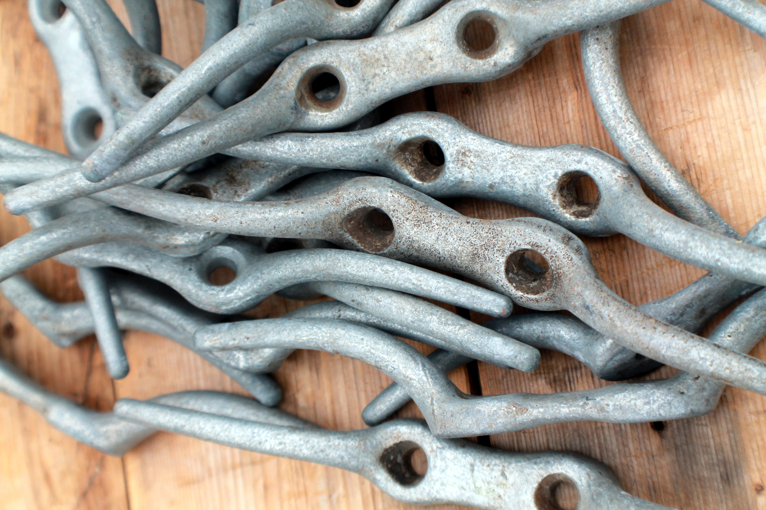 These old sailing hooks can be used as tie backs for curtains in a boys room or a home in a nautical setting. They could even be reimagined as a door or drawer handle. Give them a more dramatic look by painting them a fun color.