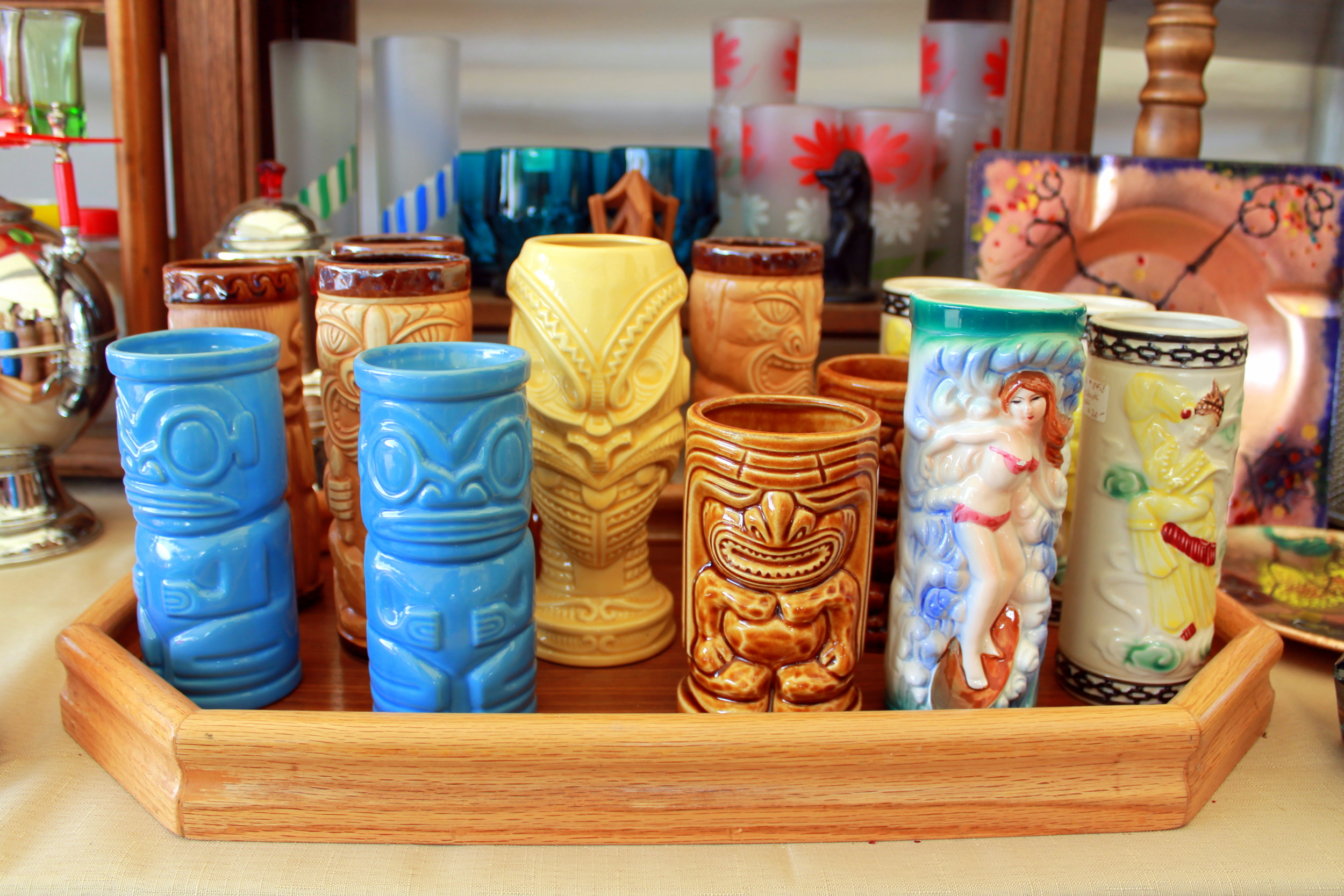 Flea markets offer the unusual. These tiki cocktail glasses add whimsy to any bar. What fun to use these at your next party!