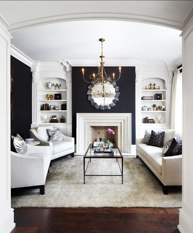 Navy blue and white evoke a more masculine and sophisticated atmosphere - a great color choice for a city home or large stately room.Designer: Laura Hay.Lisa Petrole Photography.