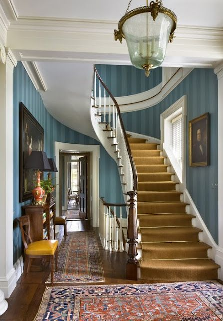 Blue is classic and timeless and traces back to Colonial times. Here blue perfectly complements the sophisticated home's austere staircase.Image via The Foo Dog Blog.