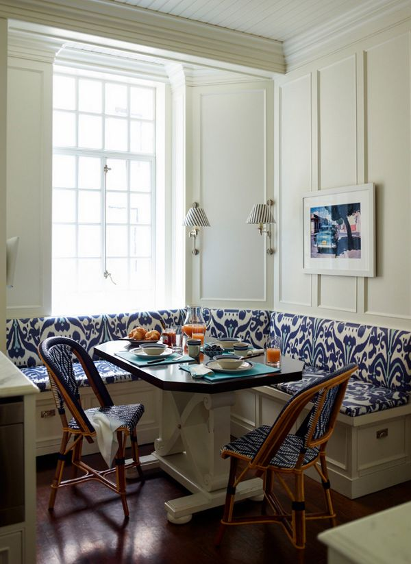 The blue and white banquette offers a modern touch to a country inspired kitchen. Image via Desire to Inspire. Ashley Whittaker Designs.