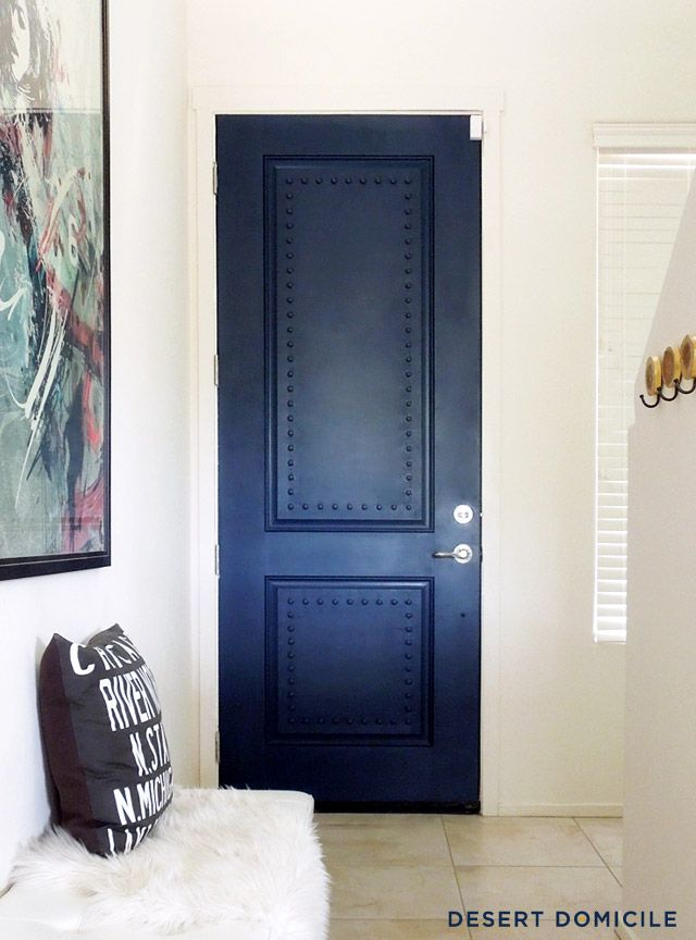 A powerful indigo colored door takes center stage.