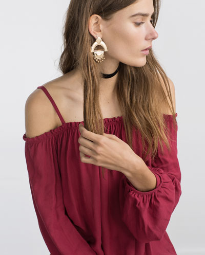 Red off the shoulder shirt by Zara