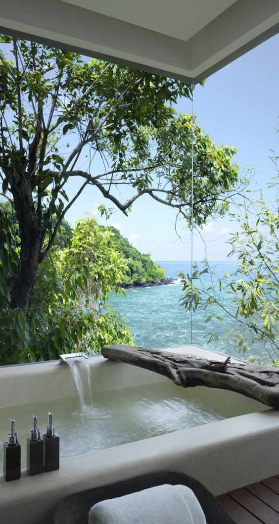Soaking up nature :: 12 Stunning outdoor baths - Image via Song Sea, Private island