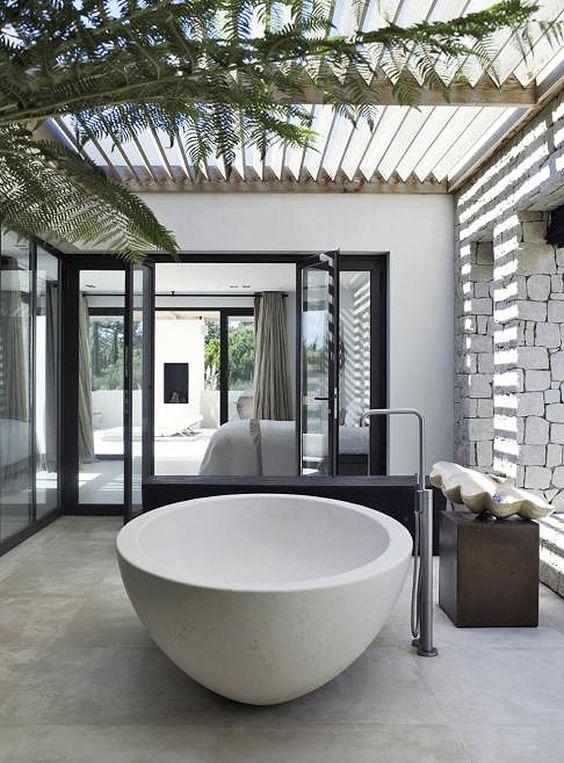 Soaking up nature :: 12 Stunning outdoor baths - Image via Piet Boon