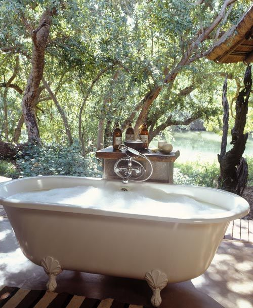 Soaking up nature :: 12 Stunning outdoor baths - Image via The Wall Street Journal