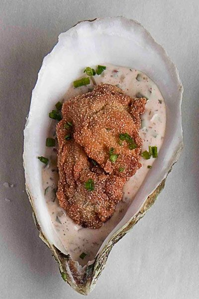 Stylish Bites :: Celebrating National Oyster Day. Image via Jessica Gordon Ryan/The Entertaining House -Some prefer their oysters deep fried.  Saveur has a recipe for deep-friend with a spicy remoulade .