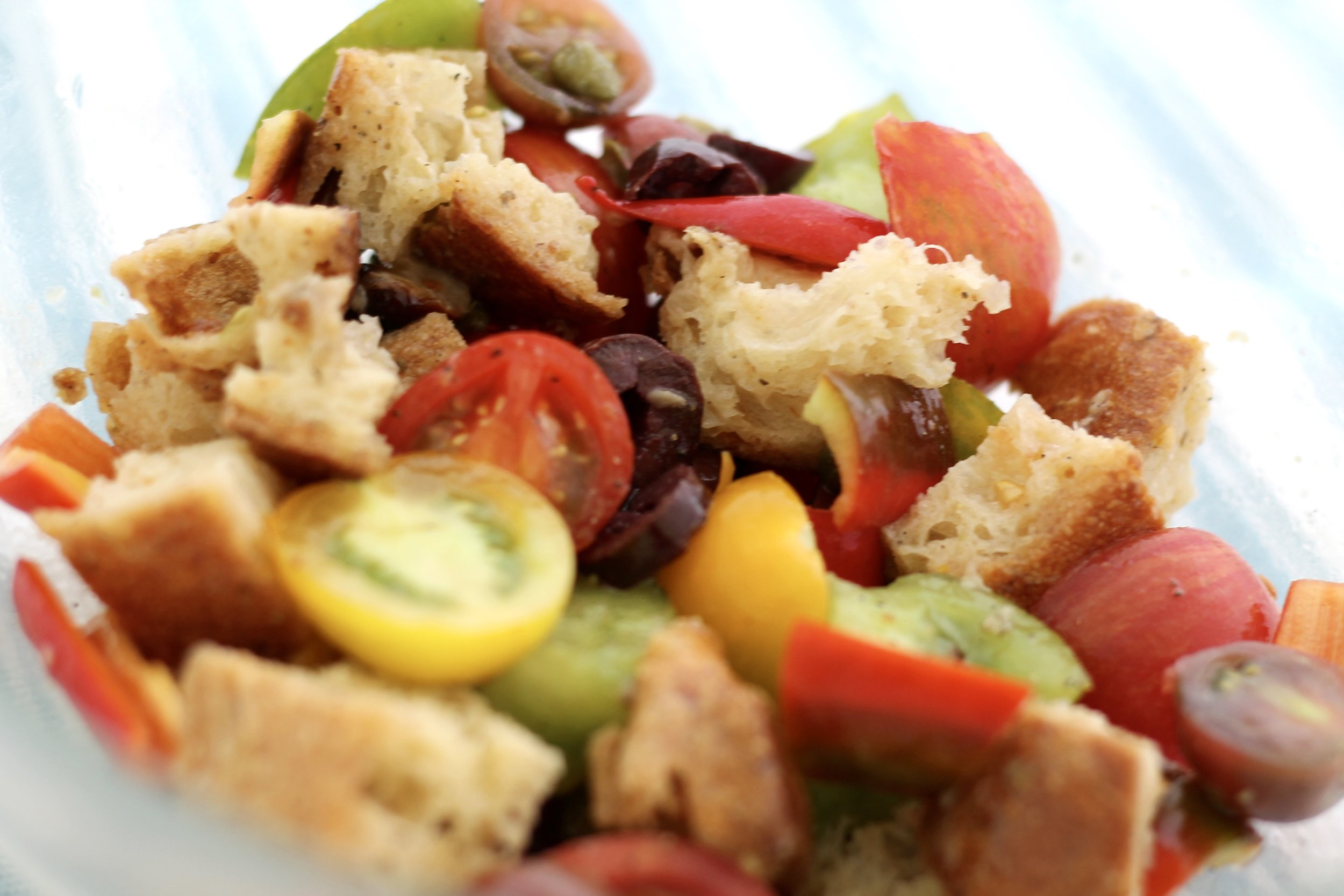 Farmer's Market Panzanella with Lemon Anchovy Dressing. Recipe and Images via The Entertaining House