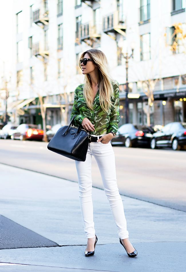 Camouflage takes a sophisticated turn in the form of a pretty blouse, worn with white jeans and heels. Image via Glam Radar