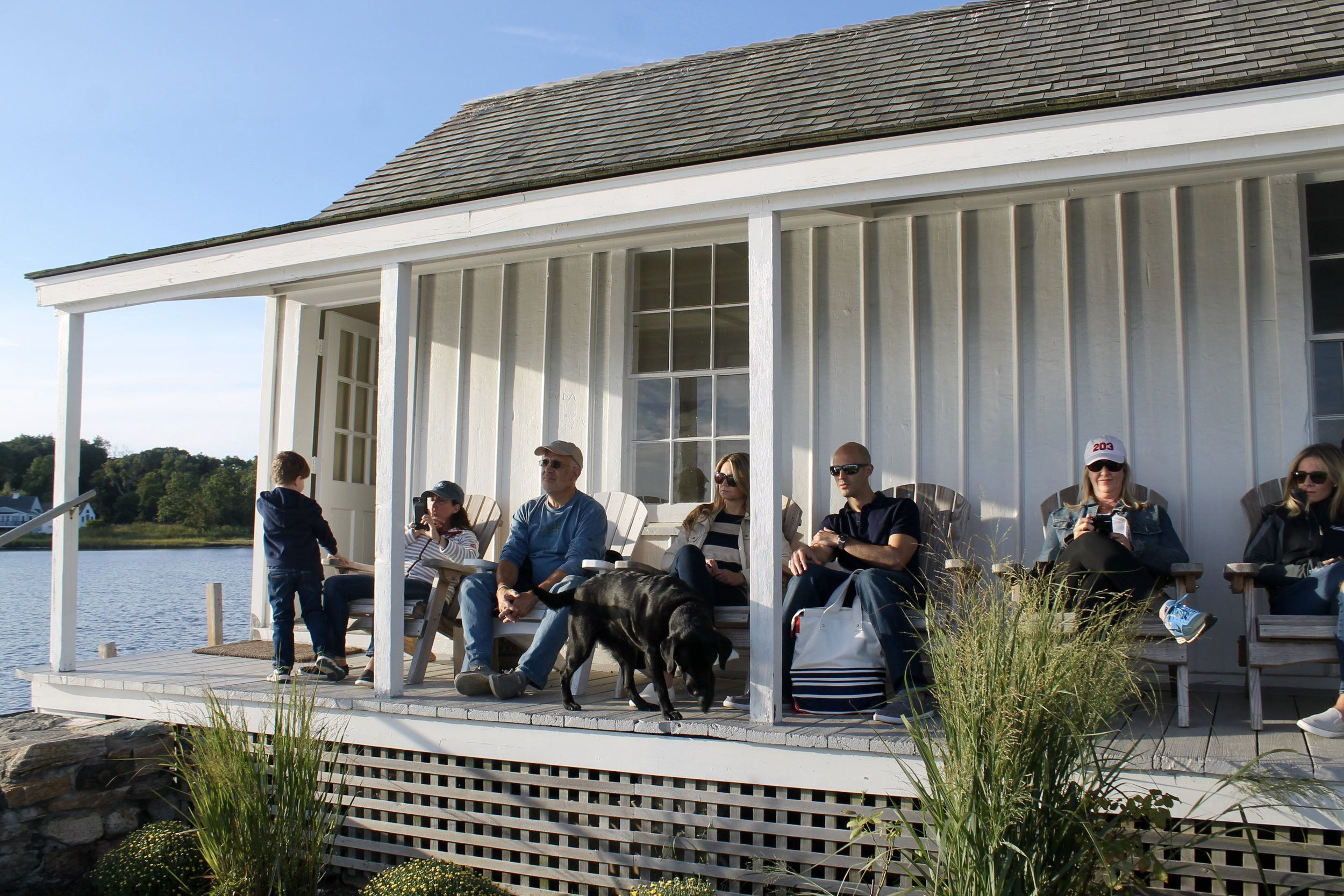 Guests enjoy themselves on the porch as Jeff Sr. discusses the intricacies of oyster farming