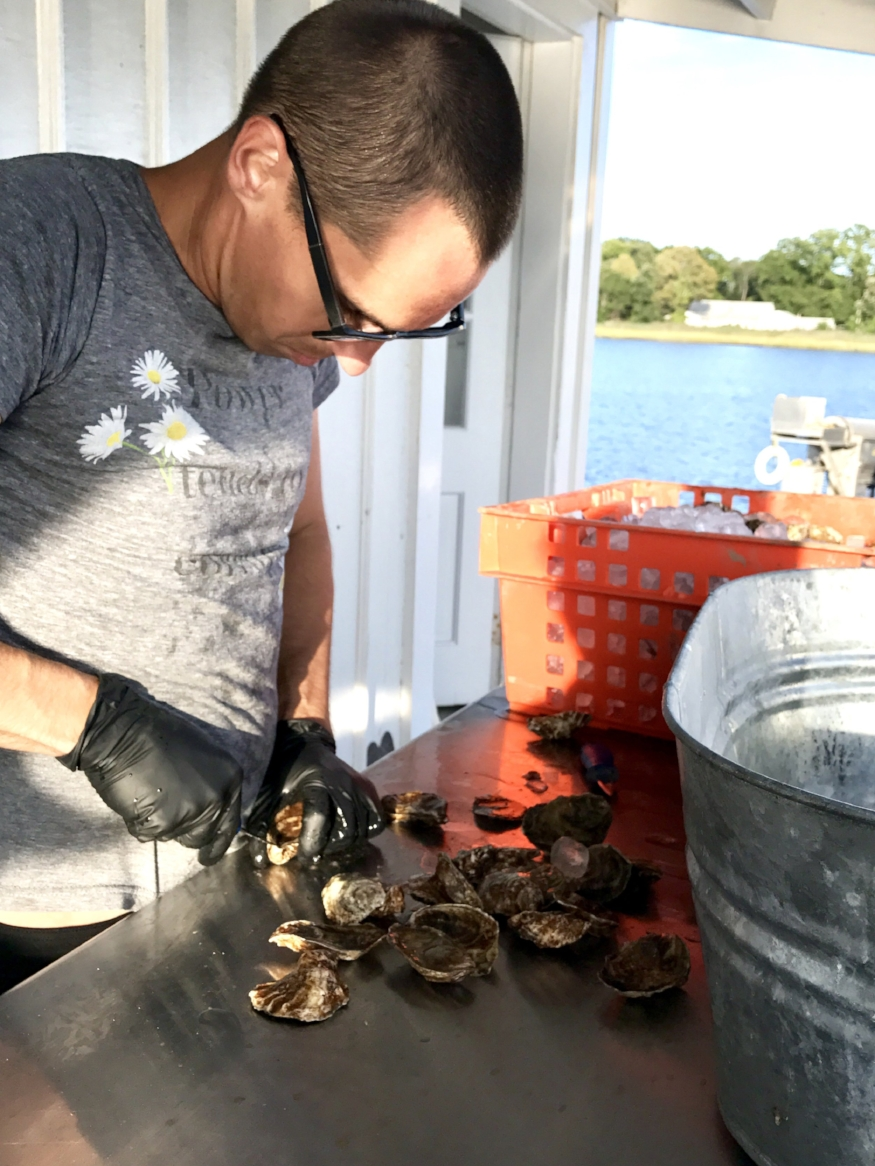 Jeff Jr shows guests how to properly shuck an oyster. (Hummock Island Oyster Tour)