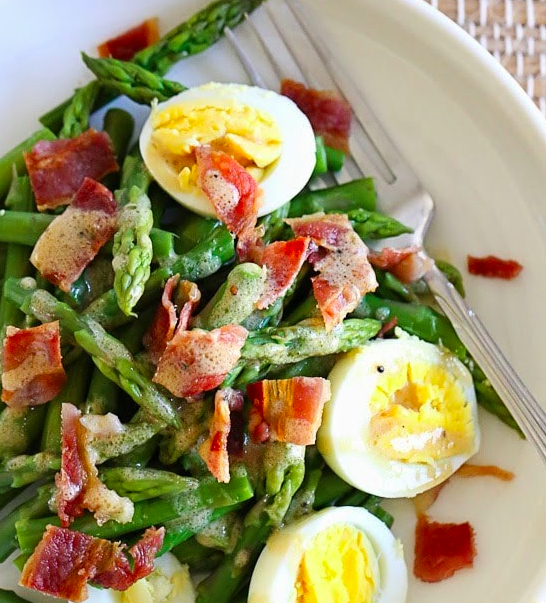 Hard boiled egg and asparagus salad. Image via Skinny Taste