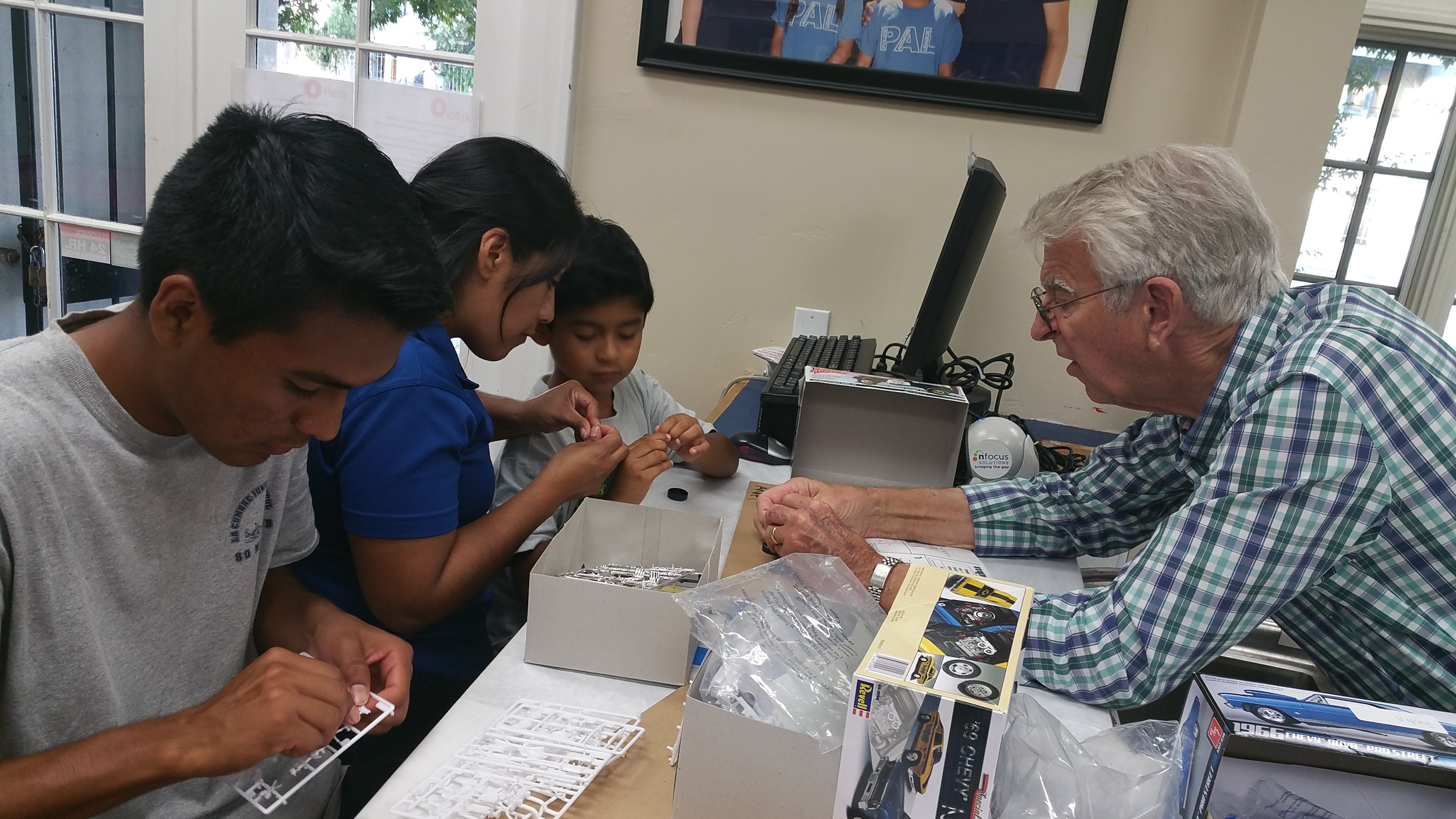 Volunteer Mike Cleary helps the children.