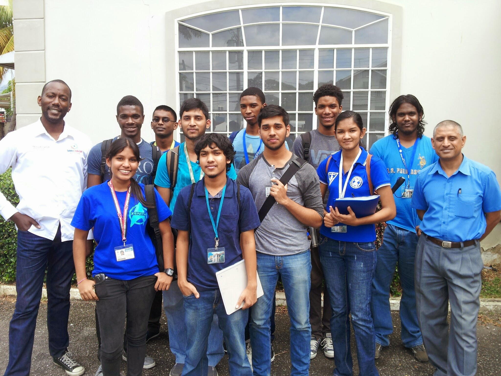 Irwin Williams –Teleios (left) stands next to University of the West Indies St. Augustine Campus' faculty of Electrical and Computer Engineering year one students and lecturer Dr. Musti Sastry.