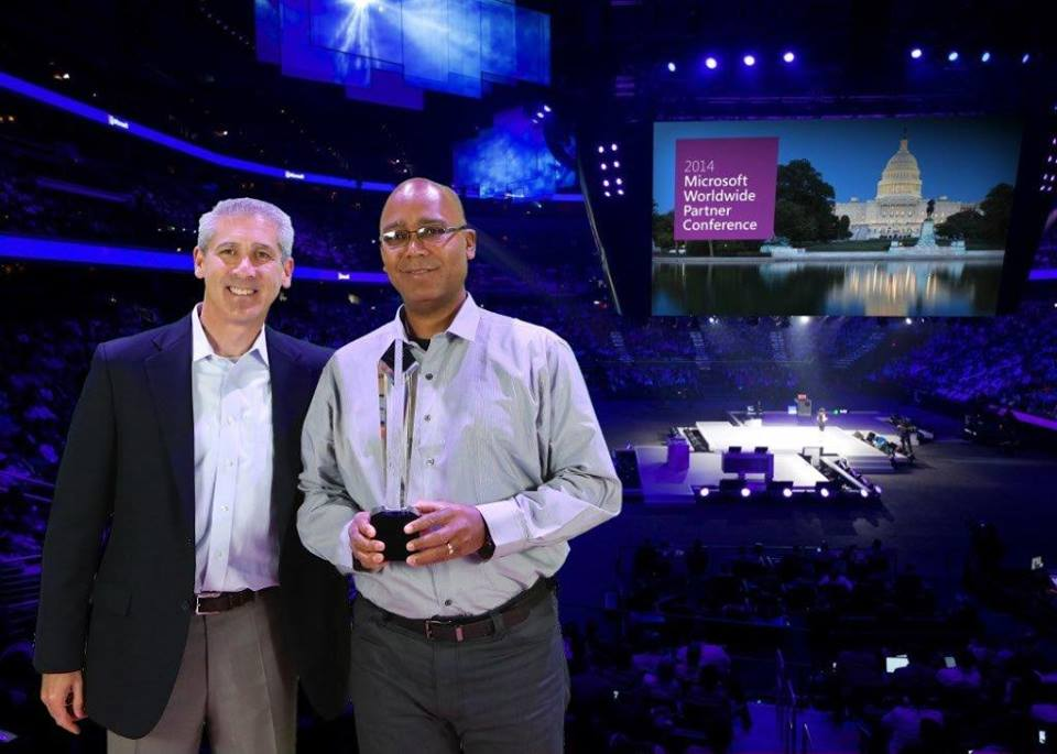 TELEIOS SYSTEMS LIMITED COO KEVIN KHELAWAN (RIGHT) RECEIVING THE MICROSOFT 2014 YOUTHSPARK CITIZENSHIP AWARD FROM MR. PHIL SORGEN (LEFT) CORPORATE VP OF MICROSOFT'S WORLDWIDE PARTNER GROUP AT THE MICROSOFT WORLD PARTNER CONFERENCE 2014