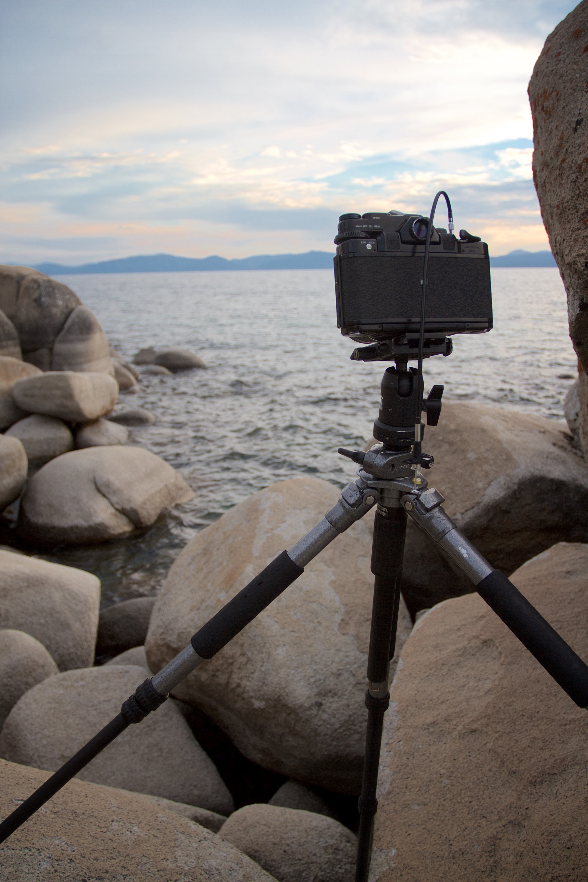 Pentax 6x7 with 55mm f/4 loaded with Kodak Ektar 100 perched on granite boulders while waiting for the light