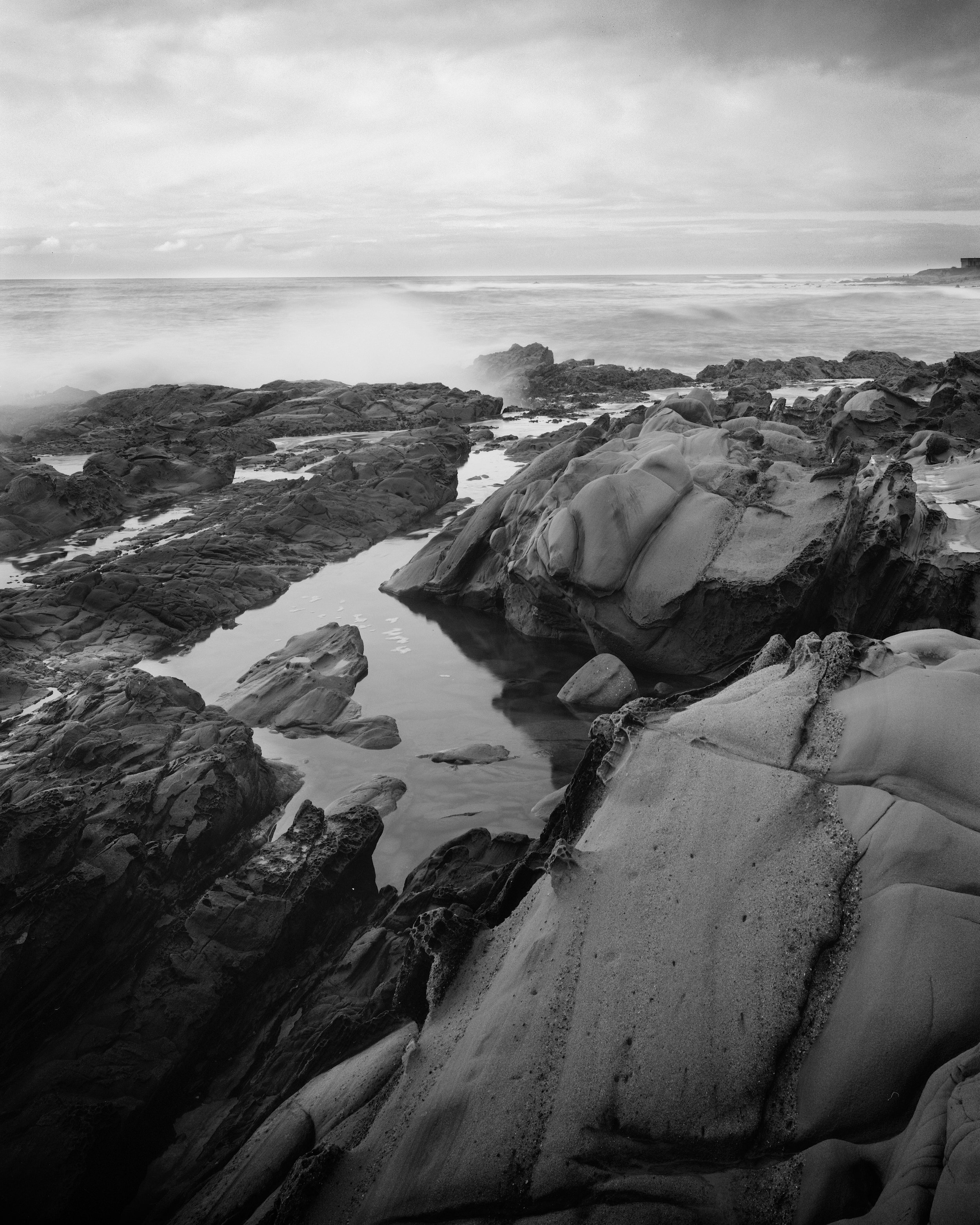 Surf breaking over tidepools. Nagaoka 4x5, Fujinon 125mm f/5.6, Ilford Delta 100