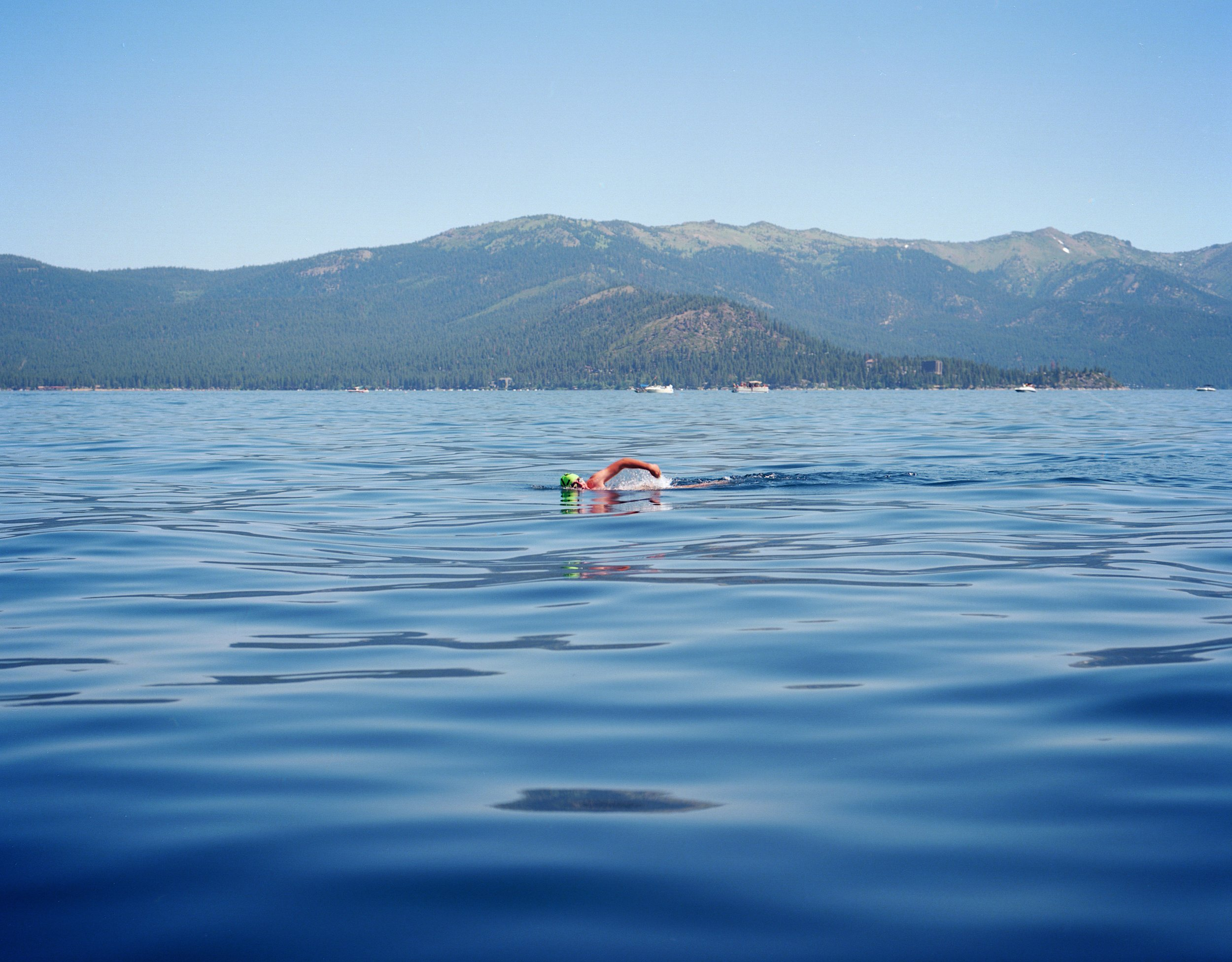 Me swimming across Lake Tahoe, 2017. Pentax 6x7 + 105mm f/2.4. I particiapted in the Trans Tahoe Relay last summer and trained a fellow relay mate on how to use the big camera between relay legs. He was able to snap this pick of me from the leader boat. While the frame is dominated by blue colors notice how the green cap and warm skin pop.