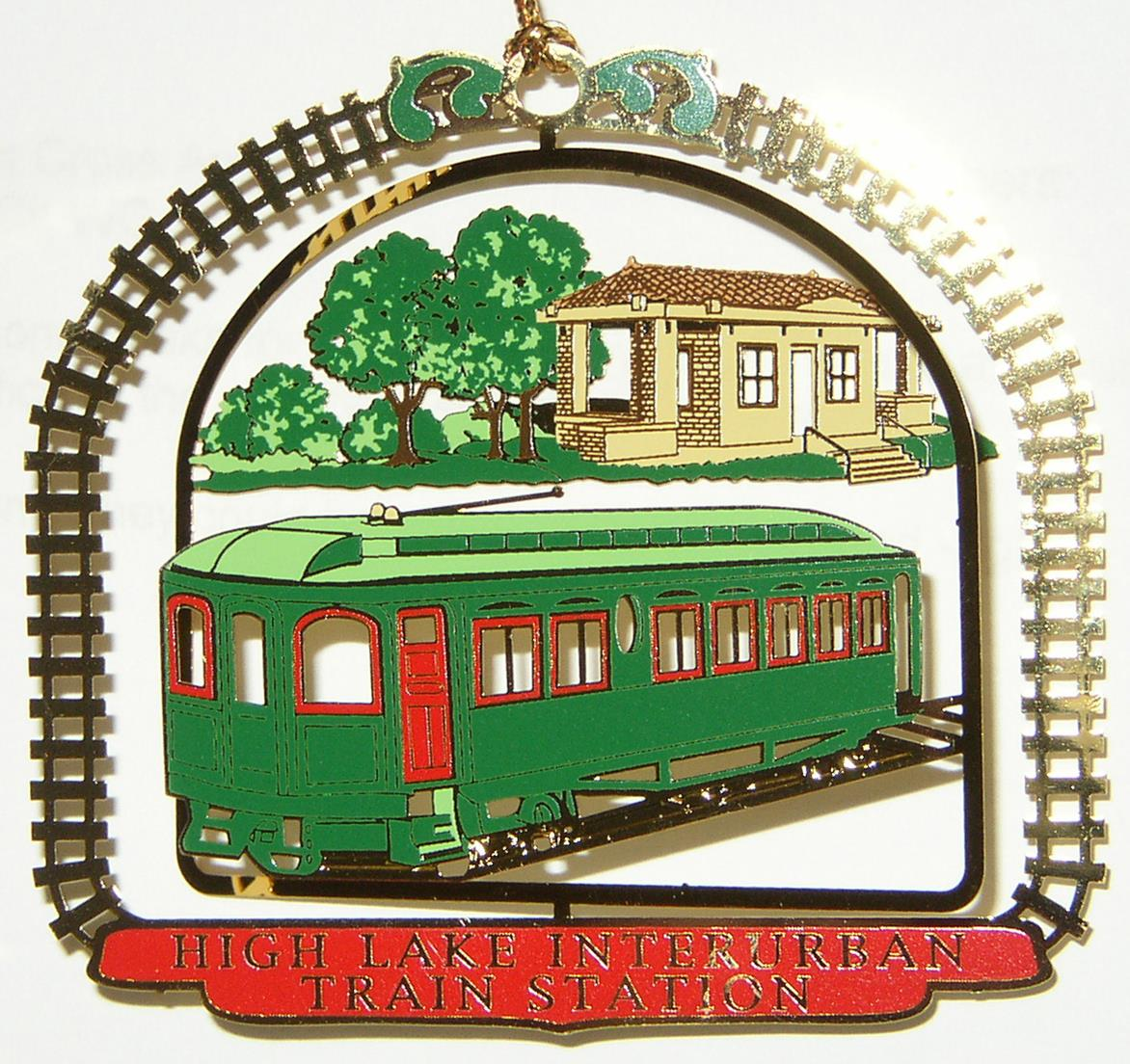 """2005- AE&C High Lake   High Lake was an early """"streetcar suburb,"""" developed in 1910, and serviced by the Geneva branch of the Aurora Elgin & Chicago (AE&C), an electric interurban railway. Commuter service began in 1909 and one could travel from High Lake to Chicago in under an hour. In 1910 an attractive brick station with a clay tile roof was built. Travelers would raise a semaphore signal to stop the train at the station. Service on the Geneva branch was discontinued in 1937."""