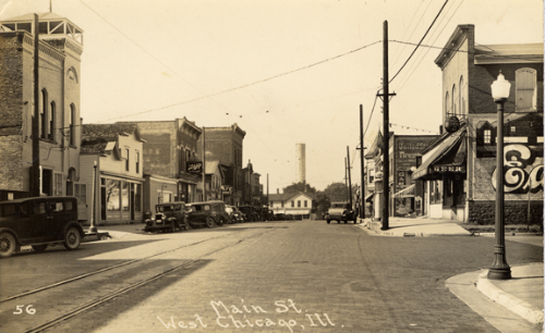 Main Street looking north, circa 1920. The former Town Hall, which now houses City Museum, is the first building on the left in this photograph.